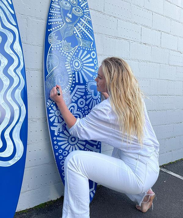 Flick is now focusing on surfing and her art.