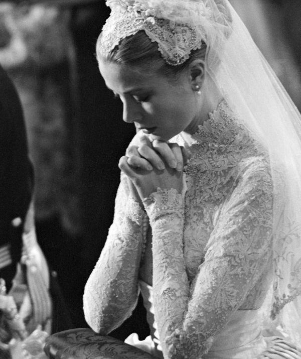 Her high-neck lace bodice will forever inspire brides.