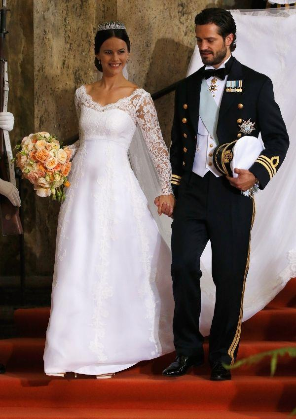 **Sofia Hellqvist**  <br><br> To marry Prince Carl Philip of Sweden, Sofia Hellqvist wore a similar lace bodice to Grace but with a rounded neckline.