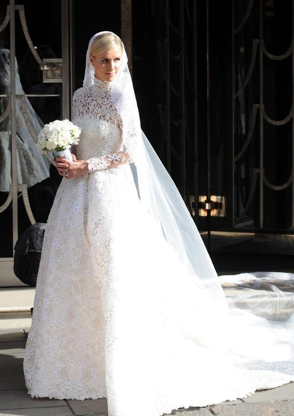 **Nicky Hilton Rothschild** <br><br> Nicky wore this divine custom lace-embroidered Valentino gown for her 2015 wedding. <br><br> Nicky channelled Grace with class through the high turtle neck lace bodice.