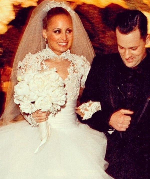 **Nicole Richie** <br><br> Nicole's custom Marchesa gown may embrace a full princess tulle skirt, but its lace bodice is a very 2000s take on Grace's 1950 creation.