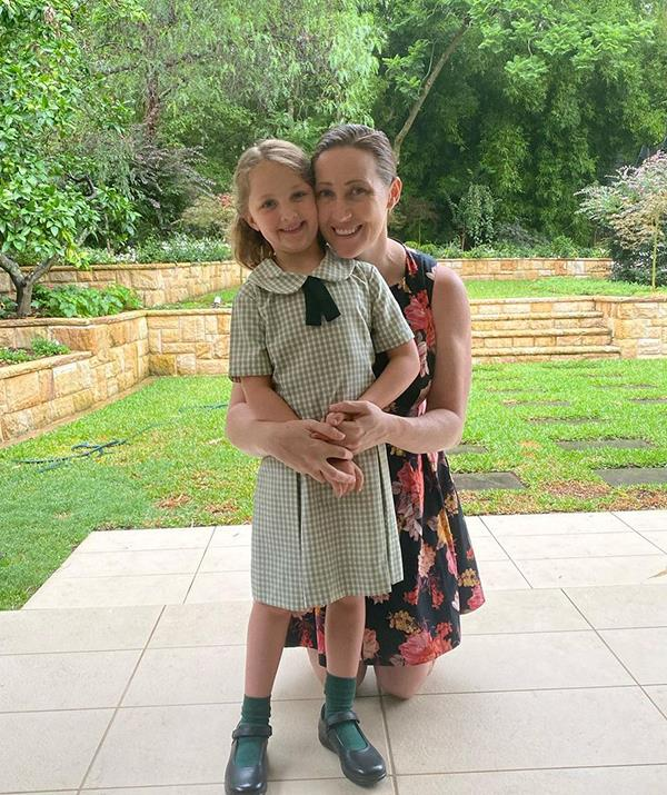 """Jana and six-year-old Emily are pictured together on her first day of kindergarten.  <br><br>  """"Such a big girl, she was ready to ditch me at the gate but I was the one who couldn't let go,"""" Jana captioned the post."""
