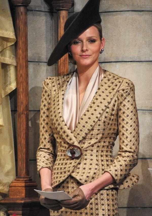 To Thanksgiving mass in 2010, Princess Charlene wore an '80s inspired brown polka dot and gold skirt and blazer. Her cropped brown leather gloves are a total highlight.