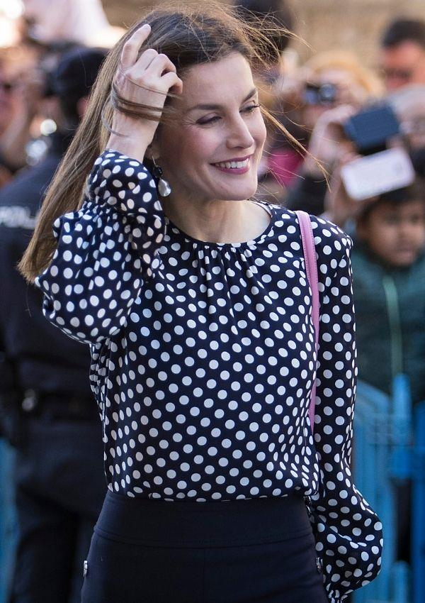 The Queen of Spain wore this classy polka dot shirt to an Easter Mass in 2018, and it's perfect office inspo.