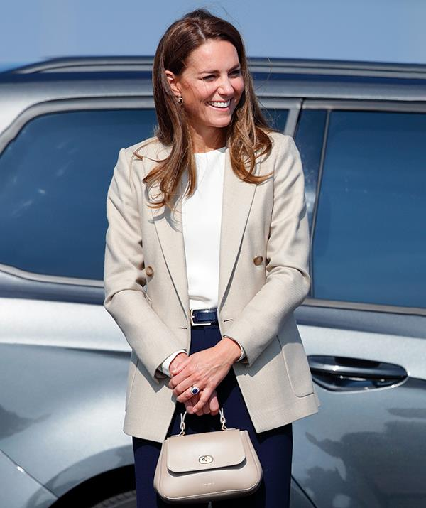 Catherine stepped out in a Reiss blazer in a trendy neutral hue, slim navy trousers and a simple blouse by Jane Atelier.