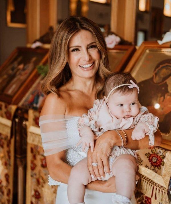 """Ada with her little Sofia! She captioned the sweet moment, """"Our beautiful Sofia's gorgeous day, love all these photos so much @elizajade And a big thank you to @velani for my dress and to @velani_christening_couture for Sofia's amazing gown."""""""