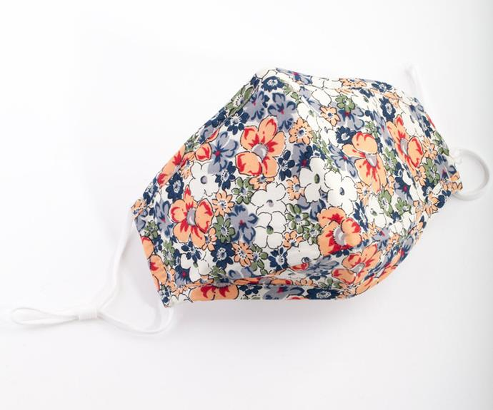 """[Shop the **Orange and Blue Flower Mask** here for $15.99.](https://fave.co/2XvU7SC