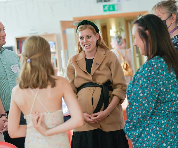 """Beatrice stepped out again just [days before giving birth](https://www.nowtolove.com.au/royals/british-royal-family/princess-beatrice-charity-baby-bump-69113