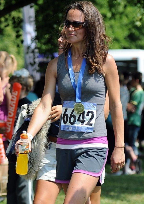 She may not be an official royal but Pippa Middleton knows the value of a functional workout look. At the GE Blenheim Triathlon in 2011, she finessed her otherwise monochromatic outfit with a pop of pink.