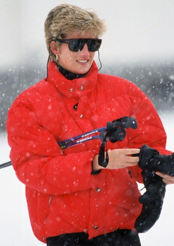 A bright red puffer jacket is one of the most accessible statement pieces a woman can own in her wardrobe, and Princess Diana loved the piece so much she was photographed wearing the stand out jacket on many ski trips.