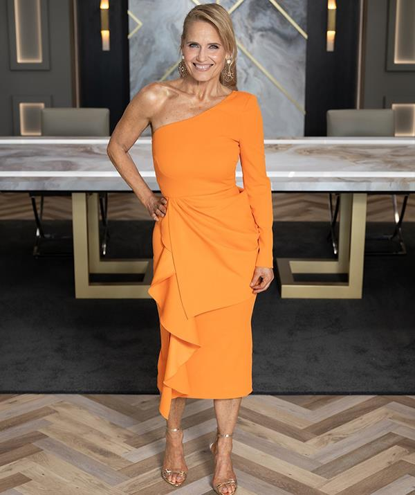 Deviating from her usual Rebecca Vallance norm, Shaynna opted for a more affordable orange crepe midi dress. <br><br> But the mother-of-two kept true to the old faithful one-shoulder with this number from Mossman, which retails for $239.