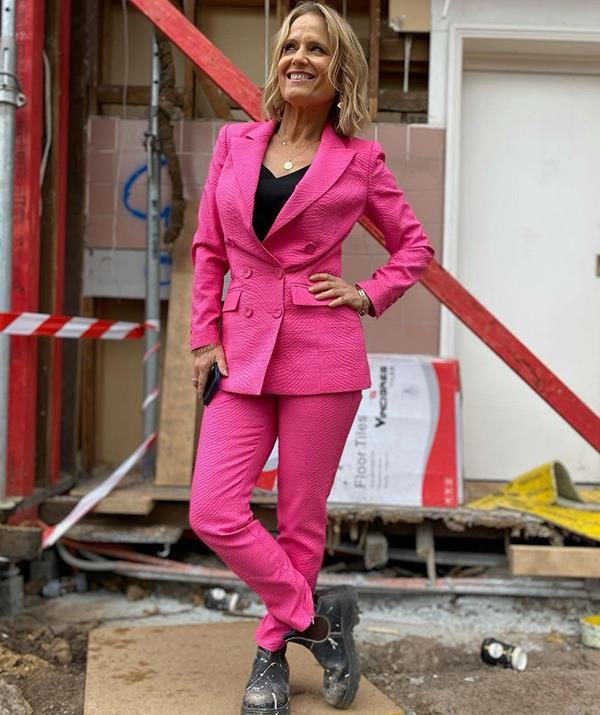 If anyone can wear muddy work boots on a construction site and still manage to look chic, it's Shaynna Blaze. <br><br> During a room reveal last month, Shaynna recycled a previously-worn Forever New cami and paired it with a fuchsia pink blazer and trousers from Mossman. <br><br> To elevate the more paired-back look, she opted for accessories from Murkani Jewellery.