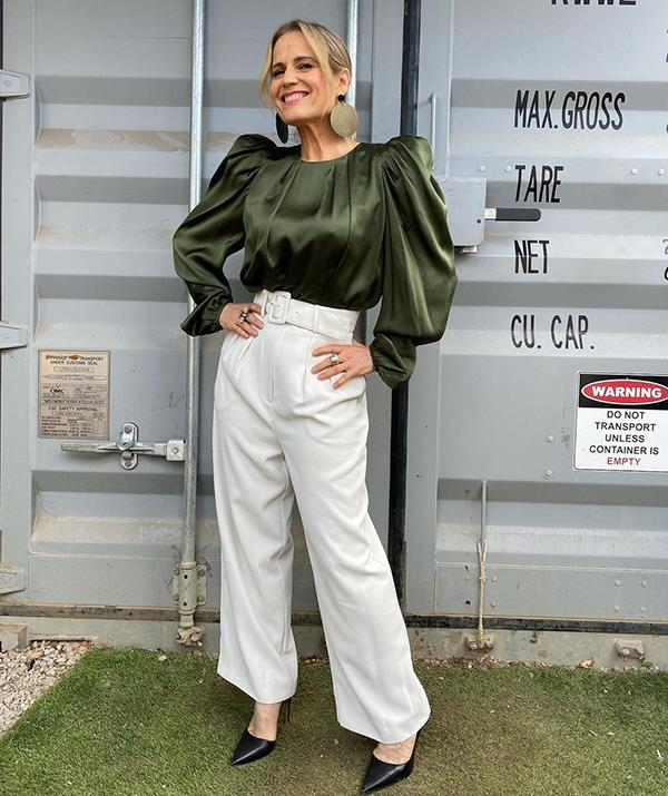 """Shaynna rang in the start of spring with a crisp white Zara trousers and olive green Aje blouse ensemble.  <br><br> """"Green symbolises springtime, freshness and renewal, so apt for tonight's show on this fifth day of spring,"""" she said of her seasonal look."""
