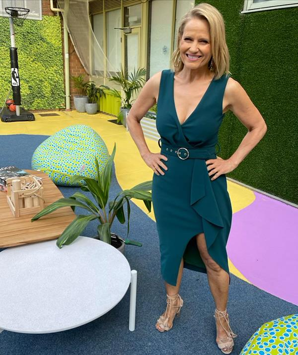 The 58-year-old looked half her age in this plunging green midi dress from Pasduchas on the set of *The Block* this month.