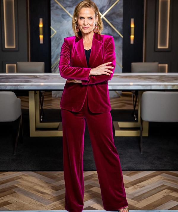The renowned designer looked every inch the boardroom boss during a grilling by Lord Sugar on *Celebrity Apprentice* earlier this year. <br><br> Shaynna kept it professional but still stylish in this pink velvet suit by Mossman.