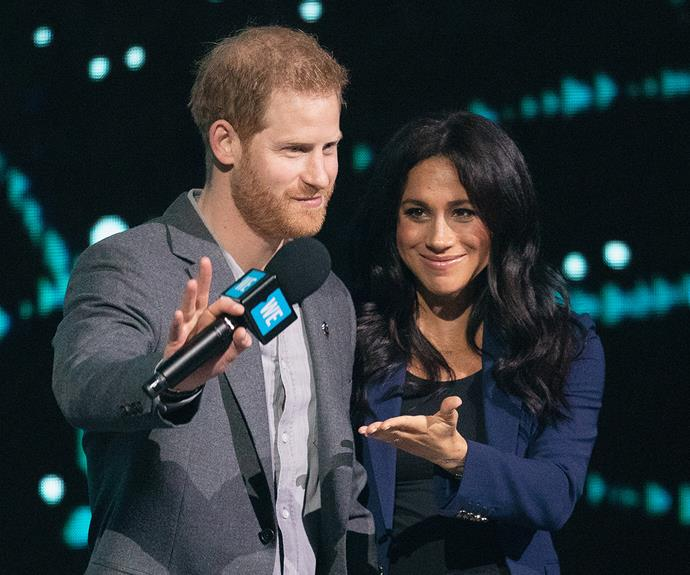Prince Harry and Meghan, Duchess of Sussex on stage at a 2019 event.