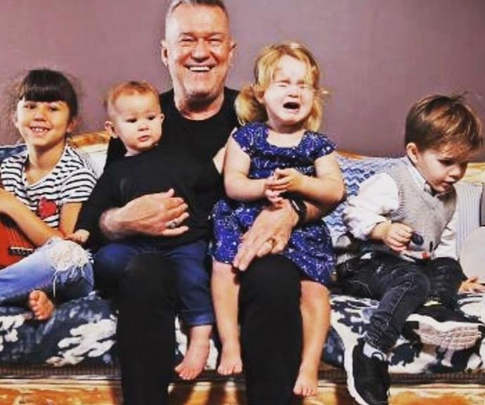 Jimmy holding four of his 15 grandchildren.