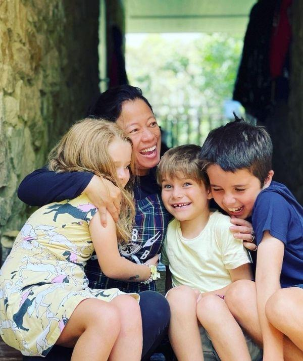 """""""Happy Birthday @jane13barnes have the most wonderful day filled with hugs. We love you so much. #birthday #leo #billyandbetty,"""" David captioned this picture of his step-mum embracing his children."""