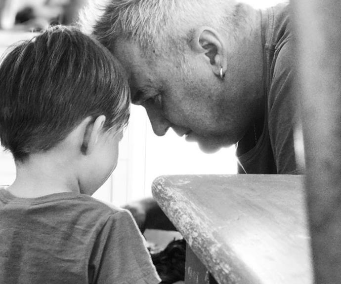 Jimmy was sharing a little moment with one of his grandsons in this black and white snap.