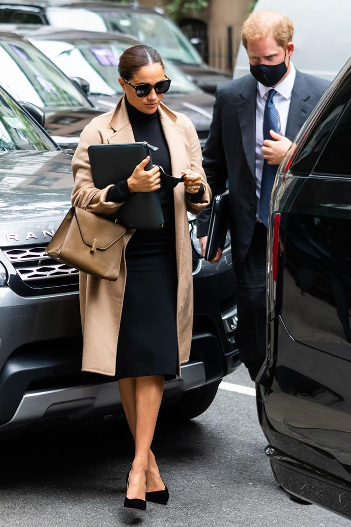 During their New York visit, Meghan stepped out in this understated ensemble, matching her Max Mara wool coat to her Valextra handbag. The rest of her outfit was in shades of black, including her Roland Mouret skirt, Armani heels, and Valentino sunglasses.