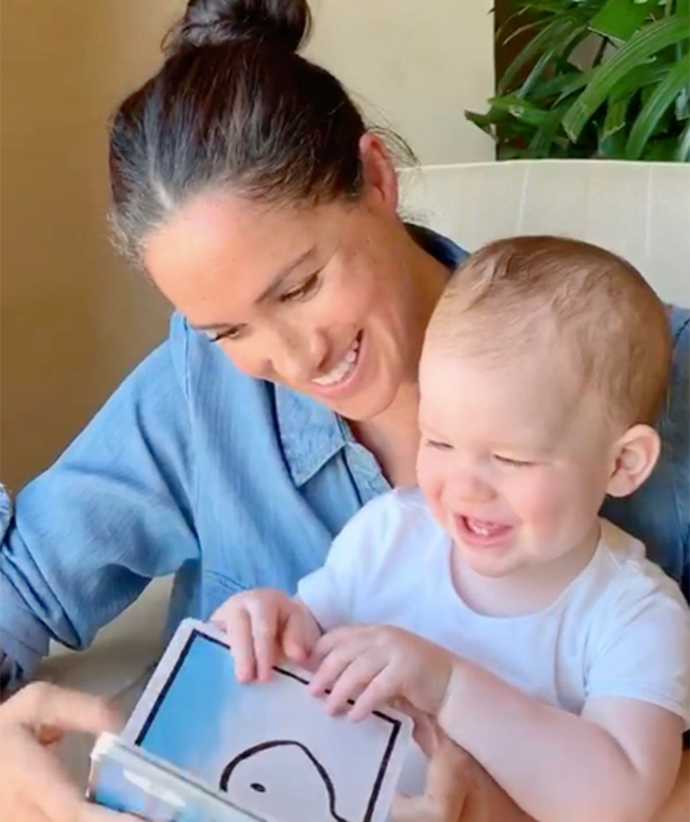 """Meghan donned a comfortable denim button-down and wore her hair in a messy bun in a [video released for Archie's first birthday](https://www.nowtolove.com.au/royals/british-royal-family/archie-first-birthday-photo-63798
