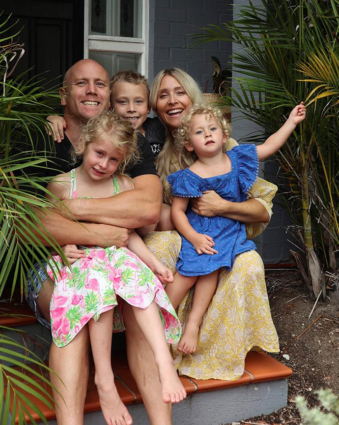 Laura with her husband and three children.