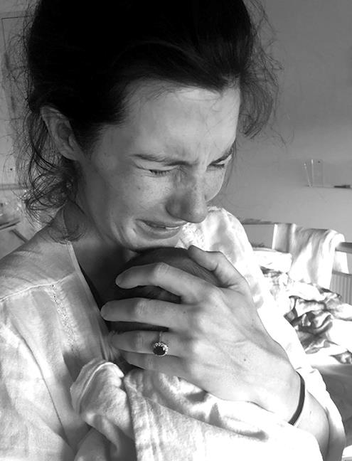 Dr Ashleigh Smith holding her daughter, Isla.