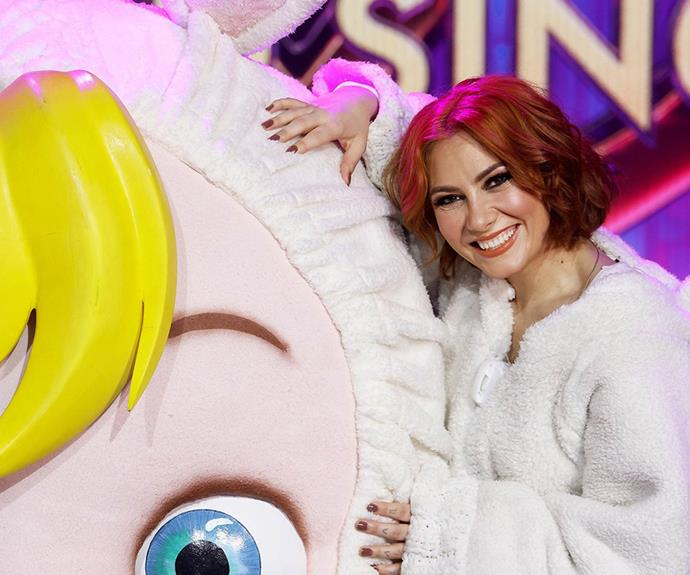 """**Baby: Ella Hooper** <br><br> Fans had been convinced for weeks that Killing Heidi singer Ella was under the baby mask - and they were right! Dannii was the only judge who managed to guess this star's identity, and Ella had prenty of fun on the show, writing on Instagram: """"What an absolute trip! Had a ball being this big beautiful bundle of back-breaking prop and animatronics!"""""""