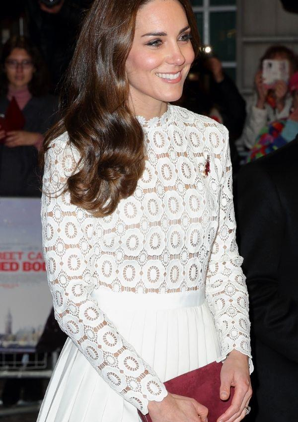 Kate perfectly matched her dusty red suede purse with her ruby broach and red blush.