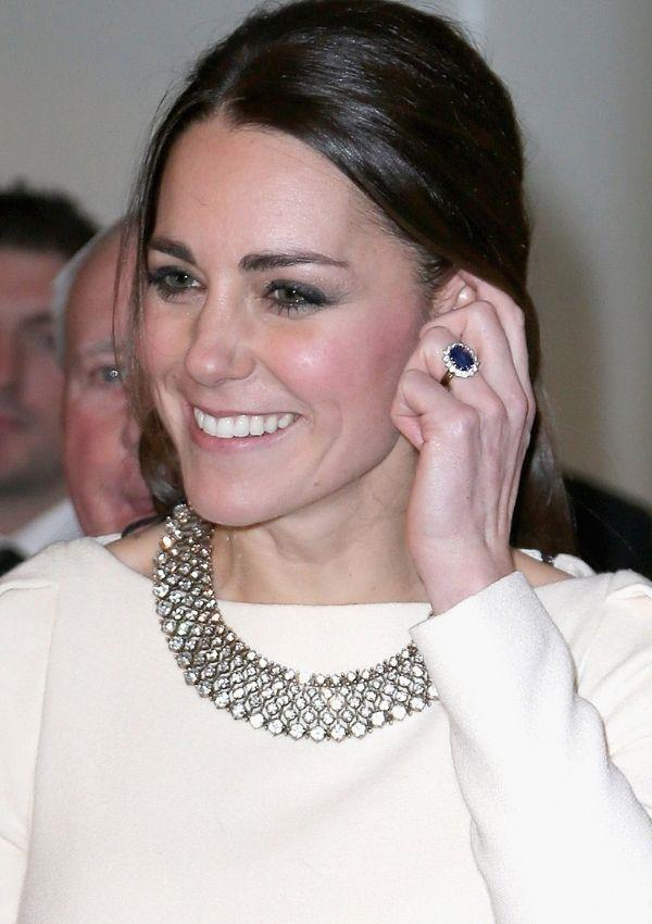 Of course, we love a shot of Kate's engagement ring, but we're equally obsessed with her large diamond necklace, which was just enough detail for her white dress.