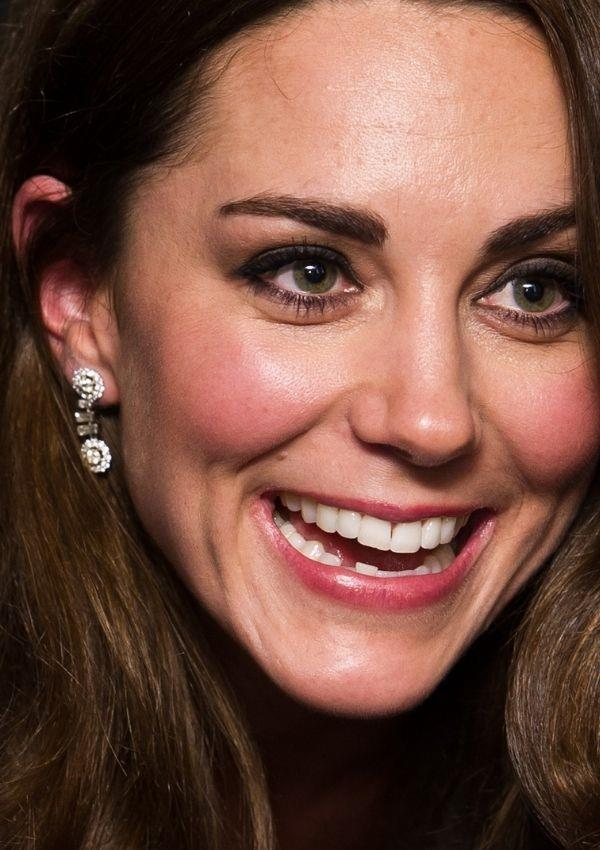 Her diamond drop earrings were a subtle styling choice that worked well with her dress, without overpowering its lace details.