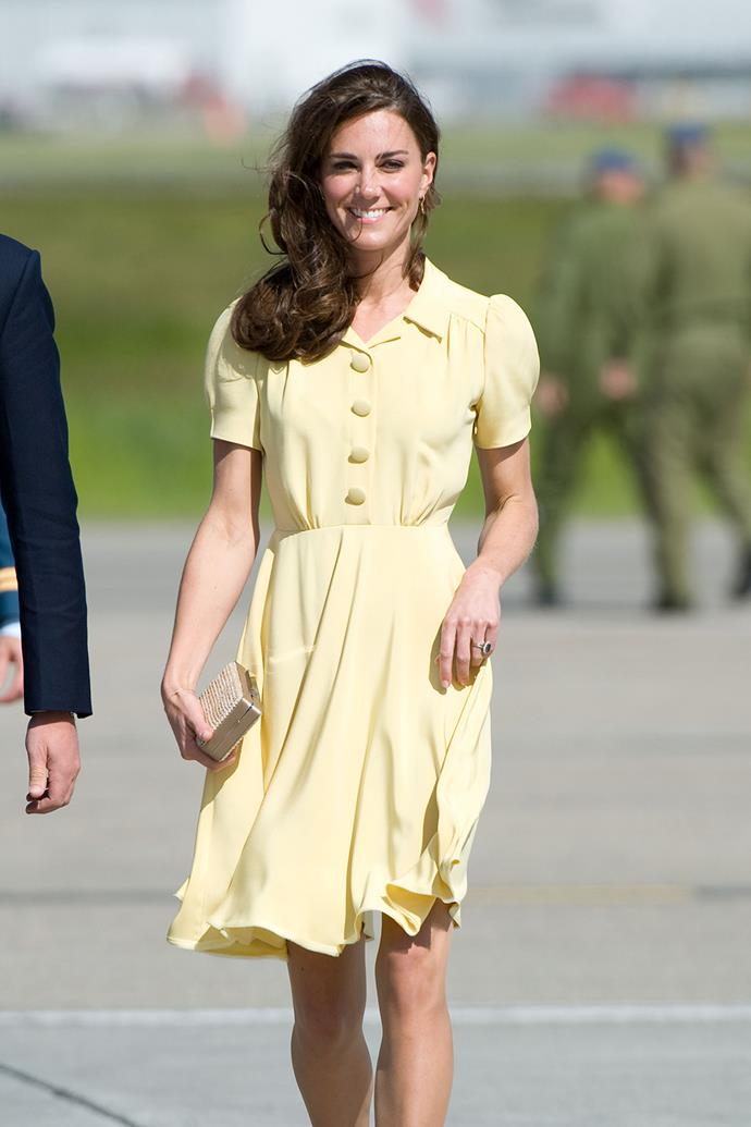 Inspired by styles from the 1940s and '50s, Catherine looked timeless in this pastel yellow frock as she arrived at Calgary Airport in 2011.