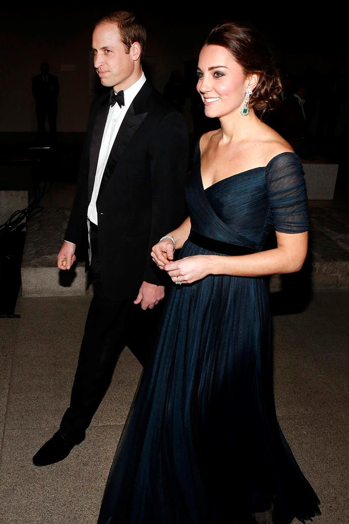 Not one to let motherhood change her approach to fashion, Catherine continued wearing Jenny Packham gowns throughout her three pregnancies. She styled this dark, floaty gown with statement jewellery in New York in December, 2014 while pregnant with Princess Charlotte.