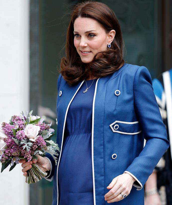 She chose this matching dress and coat for a more casual visit to the Royal College of Obstetricians and Gynaecologists in 2018, while pregnant with Prince Louis.