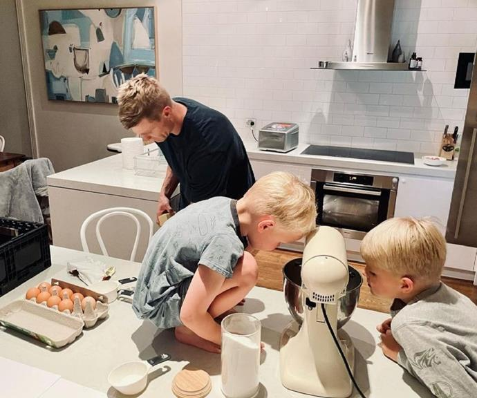 Nick shared this picture of himself brushing up on his cooking skills ahead of his appearance on Celebrity MasterChef, with his curious boys beside him.