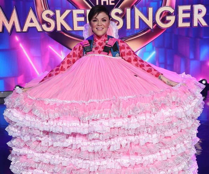 Em Rusciano popped off her giant Dolly head and was named the runner up of *The Masked Singer Australia* 2021.