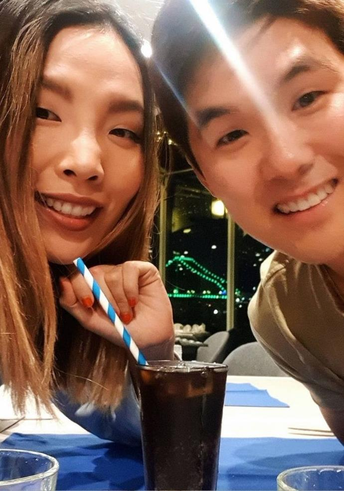 """For their eighth anniversary Dami captioned this moment, """"8 years anniversary today 🎉🎉🎉 We are a bit cute we knnow!! So glad I picked someone who loves food as much as I do.. I love being stuck with you @nkim_ 🧡🧡🧡."""""""