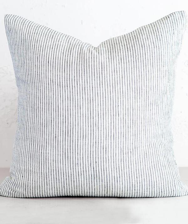 """[**Cushions**](https://livingbydesign.net.au/products/lyon-french-linen-stripe-cushion-60-x-60-natural-grey?variant=31804099395697&currency=AUD&gclid=Cj0KCQjwwY-LBhD6ARIsACvT72NFh0Kl_OF_e8AGNKypgtXFsOwVmkrQA3tWSAieNRqR6_bHqKak2OoaAtIVEALw_wcB target=""""_blank"""") <br><br> Who doesn't love a good scatter cushion? And for the warmer months, linen is the perfect breathable fabric to incorporate into a Christmas gift. <br><br> Created from superior quality linen for a relaxed textured approach to home styling, the $69 Lyon Vintage Washed French Linen Stripe cushions from Living By Design offer a timeless quality and are the perfect present if you're on a budget."""