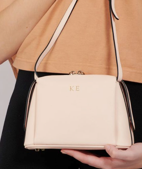 """[**Personalised bag**](https://www.thedailyedited.com/pale-pink-structured-cross-body-bag target=""""_blank"""") <br><br> There's a reason personalised gifts are an old faithful go-to gift every Christmas. And The Daily Edited, AKA the queens of monogramed accessories, have enough on offer this year to have your entire shopping list covered. <br><br> From phone cases, wallets, laptop bags and totes, The Daily Edited is your one-stop monogram shop. <br><br> We love the versatile Pale Pink Structured Cross Body Bag, which retails for $170 and includes up to four personalised letters. You'll also be able to pick out which font, colour, size and text position best suits your needs."""