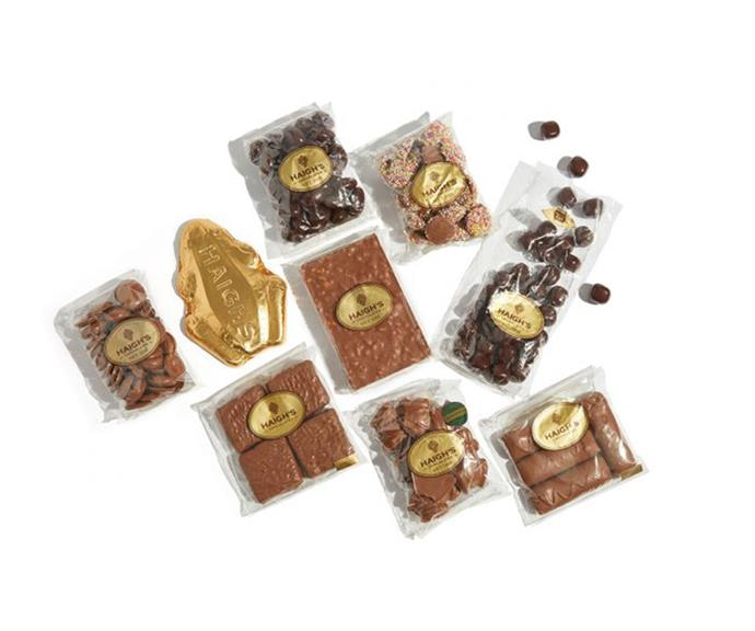 """[**Haigh's chocolate**](https://www.haighschocolates.com.au/introductory-selection target=""""_blank"""") <br><br> You'd be hard pressed finding someone that wouldn't be happy to receive chocolate as a gift all year round. <br><br> The artisan chocolate company has created the perfect bundle in time for Christmas, featuring their most popular treats. For $120, including delivery, Haigh's introductory package has all your cacao needs sorted, from milk, dark and white chocolate. <br><br> The package includes milk speckles, milk chocolate peppermint frogs, milk marshmallow kokettes, honeycomb blocks and truffle bars."""