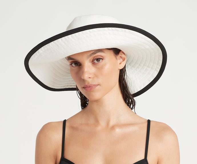 """[**Sunhat**](https://sirthelabel.com/collections/accessories/products/maurice-floppy-hat-1 target=""""_blank"""") <br><br> You can never go wrong with gifting someone a hat, particularly in Australian summer. <br><br> This SIR wide brim ivory canvas hat, which features topstitching and a contrast binded edge, will keep your loved ones sun-safe and on trend."""