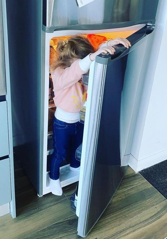 We bet Erin pretended she couldn't see Eliza in the fridge when they played a game of hide and seek.