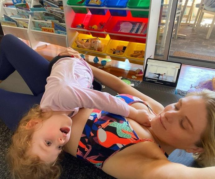 """Erin shared this silly snap from her workouts in lockdown, and she captioned the moment, """"You know it's getting desperate when you look to your 3 year old for acknowledgment, reassurance and compliments 😬😳🙌."""""""