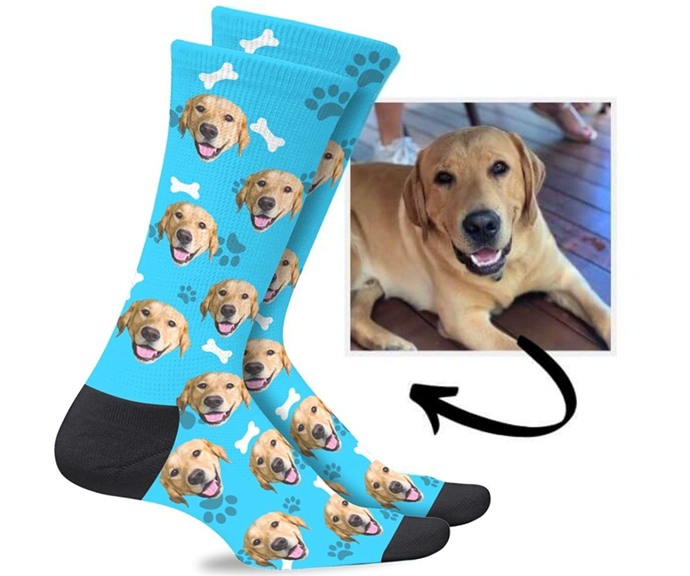 """**Personalised socks** <br><br> If you're looking for the perfect gag gift or stocking filler, look no further than personalised socks. <br><br> The pair can be customised with any photo you want - whether it be a photo of your dog, your kids or even a pic of you! <br><br> Custom Dog Socks, $34.95, [Pulse Socks](https://pulsesocks.com.au/collections/custom-socks-australia/products/custom-dogs-socks