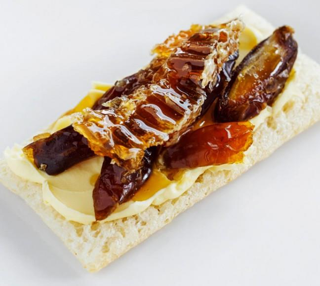 Decadent and delightful Ingredients: Crème fraîche, medjool dates and honeycomb.  Take a dollop of crème fraîche, mascarpone or cream cheese as your base, add some sliced medjool dates (don't forget to remove the pip) and then finish with a big, chunky slice of pure honeycomb on top!