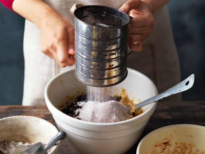 After incorporating the eggs, stir the butter mixture into the fruit mixture. Stir in the sifted flours and any other dry ingredients as indicated by whatever recipe you are using.