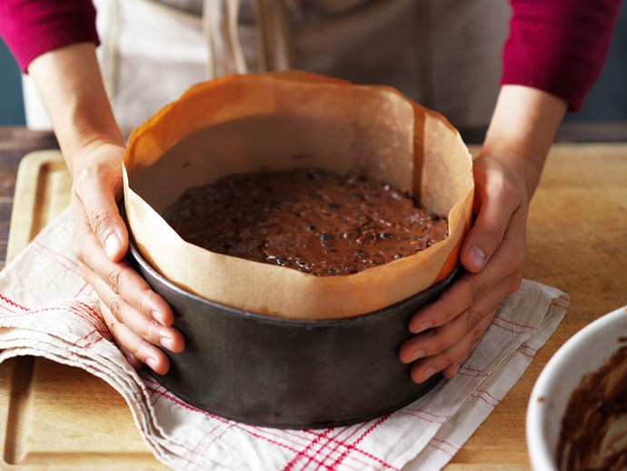 Hold the pan with both hands and bang it down hard on the bench (or drop it from about 20cm). Do this a couple of times to settle the mixture, and get rid of large air bubbles. Bake.