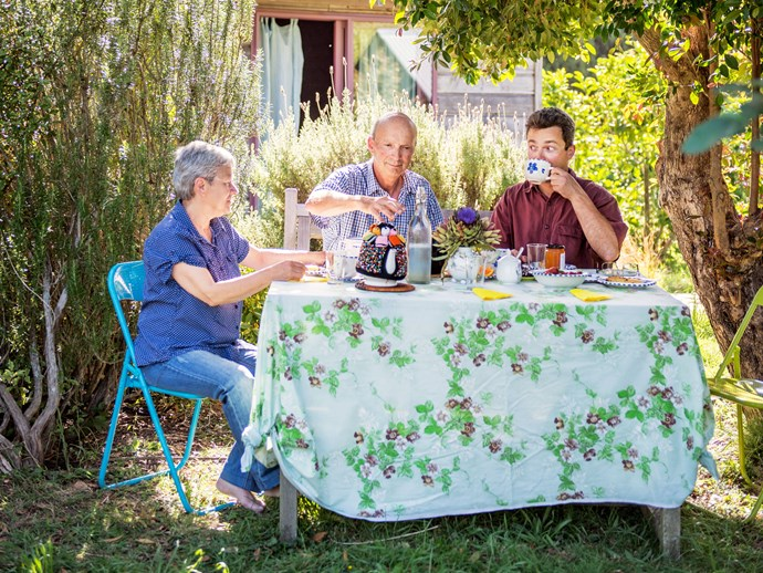Peter, Angelika and son Korbinian enjoy a cuppa in the garden.