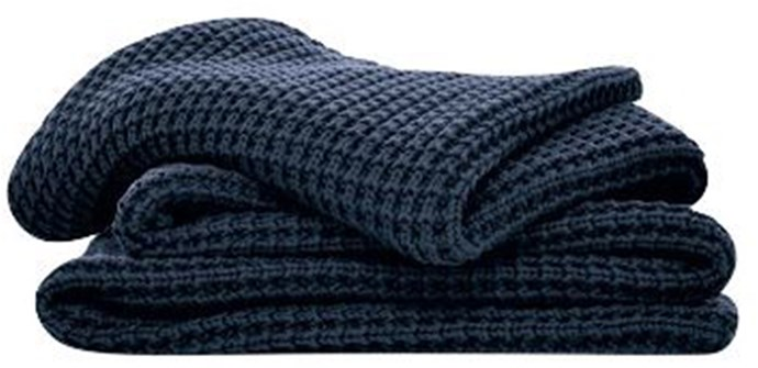 Sheridan throw, $230, from [Smith & Caughey's.](https://www.smithandcaugheys.co.nz/shop/home/bedroom/quilts-throws/haden-throw)