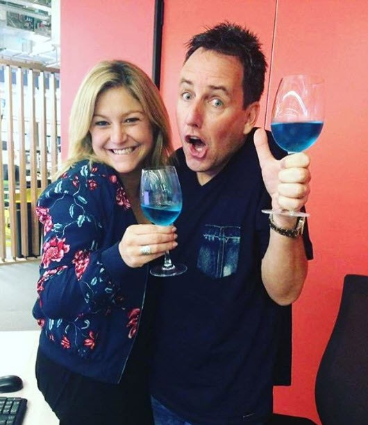 Toni Street and Mike Hosking enjoy a glass of the, err, blue stuff?
